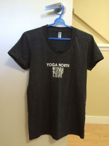 YOGA NORTH The preceding Winnipeg moments were fringe benefits. My main objective in Winnipeg? To pass my Intermediate Junior I assessment. I, along with five fellow candidates, passed. Here's my souvenir tee shirt from Yoga North, which was an excellent venue. I held off buying it until I knew that Winnipeg and Yoga North would be a happy memory.